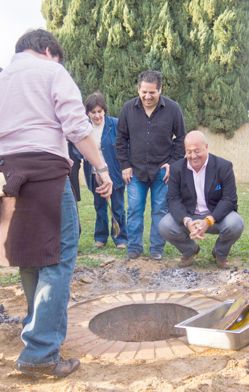 Paco cooking Barbacoa in underground oven with Andrew Zimmern and Bill Esparza